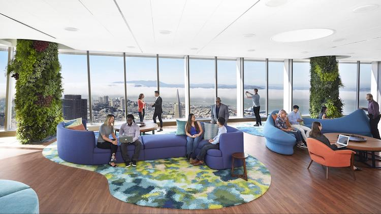 Visitors sit and enjoy the view in the 61st floor's lounge area
