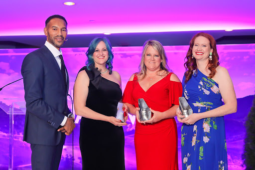 Tony Prophet, Chief Equality Officer at Salesforce awarding RAD Women (from left to right) Kieren Jameson, Angela Mahoney, and Melissa Hansen
