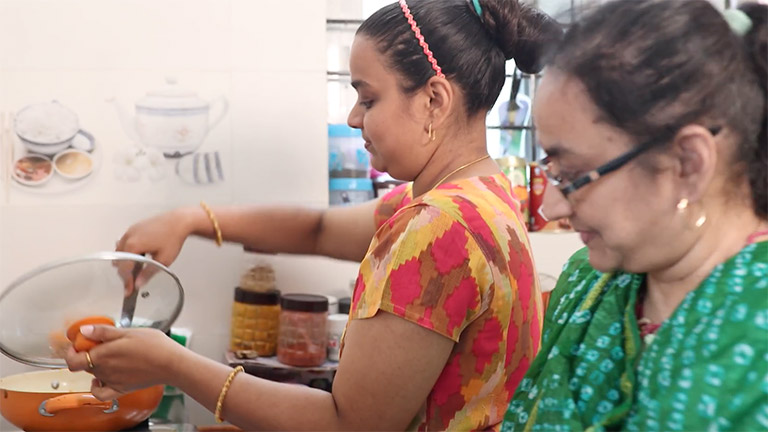 Tejaswi Attot in the kitchen with her mother