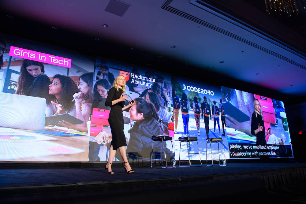 Olivia Khalili speaking onstage at a conference.